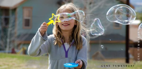 Candid photo of child with bubbles