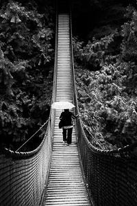 Photography composition Rule of symmetry - girl on bridge
